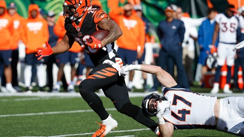 <p>               FILE - In this Dec. 2,2018, file photo, Cincinnati Bengals running back Joe Mixon (28) breaks a tackle-attempt by Denver Broncos inside linebacker Josey Jewell (47) in the first half of an NFL football game, in Cincinnati. Mixon has been one of the few bright spots during the Bengals' eight-game implosion. (AP Photo/Frank Victores, File)             </p>