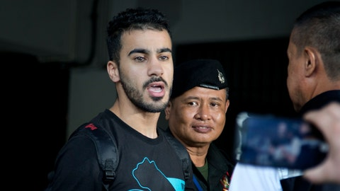 <p>               Bahraini football player Hakeem al-Araibi, left, answers questions from the waiting journalists as he is brought in to a court in Bangkok, Thailand, Tuesday, Dec. 11, 2018. A Thai court has ruled that the soccer player who holds refugee status in Australia can be held for 60 days pending the completion of an extradition request by Bahrain, the homeland he fled four years ago on account of alleged political persecution. (AP Photo/Gemunu Amarasinghe)             </p>