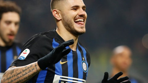 <p>               Inter Milan's Mauro Icardi celebrates after scoring his team's first goal on a penalty kick during an Italian Serie A soccer match between Inter Milan and Udinese, at the San Siro stadium in Milan, Italy, Saturday, Dec. 15, 2018. (AP Photo/Antonio Calanni)             </p>