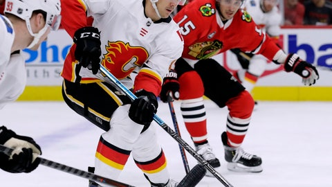 <p>               Calgary Flames center Mikael Backlund (11) controls the puck during the first period of an NHL hockey game against the Chicago Blackhawks, Sunday, Dec. 2, 2018, in Chicago. (AP Photo/Nam Y. Huh)             </p>
