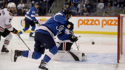 <p>               Winnipeg Jets' Kyle Connor (81) scores on Chicago Blackhawks goaltender Cam Ward (30) during the second period of an NHL hockey game, Tuesday, Dec. 11, 2018, in Winnipeg, Manitoba. (Trevor Hagan/The Canadian Press via AP)             </p>