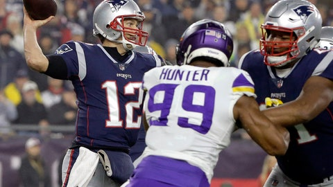<p>               New England Patriots quarterback Tom Brady (12) passes under pressure from Minnesota Vikings defensive end Danielle Hunter (99) during the first half of an NFL football game, Sunday, Dec. 2, 2018, in Foxborough, Mass. (AP Photo/Steven Senne)             </p>