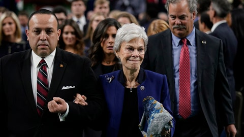 <p>               Jerry Reyes, with the Geo. H. Lewis & Sons funeral home, escorts widow Janice McNair, followed by her son Cal McNair, after a public celebration of life for Houston Texans owner Robert C. McNair at NRG Stadium, Friday, Dec. 7, 2018, in Houston. McNair, who brought the NFL back to Houston after the Oilers left for Tennessee, died Nov. 30 at 81. (AP Photo/David J. Phillip, POOL)             </p>