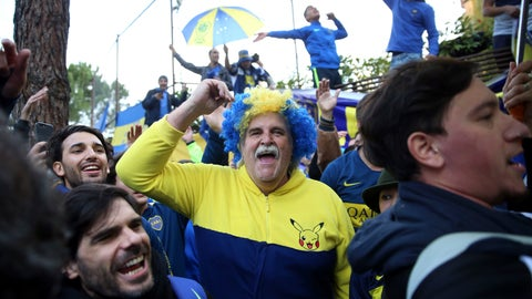 <p>               Boca Juniors supporters cheer during a gathering outside the team hotel in Madrid Saturday, Dec. 8, 2018. The Copa Libertadores Final between River Plate and Boca Juniors will be played on Dec. 9 in Madrid, Spain, at Real Madrid's stadium. (AP Photo/Andrea Comas)             </p>