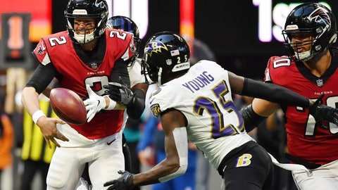 <p>               Atlanta Falcons quarterback Matt Ryan (2) fumbles the ball as Baltimore Ravens cornerback Tavon Young (25) works the pick up during the second half of an NFL football game, Sunday, Dec. 2, 2018, in Atlanta. Young scored a touchdown on the play. The Baltimore Ravens won 26-16. (AP Photo/Danny Karnik)             </p>