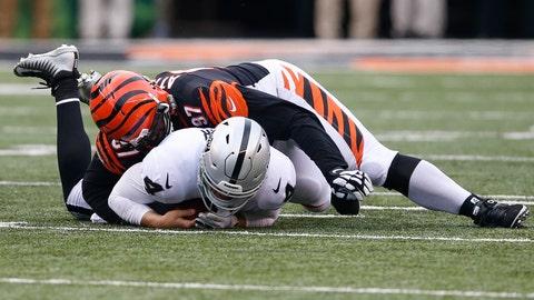 <p>               Cincinnati Bengals defensive tackle Geno Atkins (97) sacks Oakland Raiders quarterback Derek Carr (4) in the second half of an NFL football game, Sunday, Dec. 16, 2018, in Cincinnati. (AP Photo/Gary Landers)             </p>