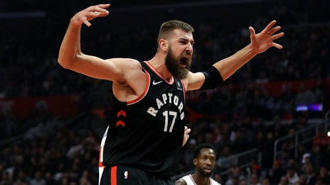 <p>               Toronto Raptors' Jonas Valanciunas (17) reacts after scoring against the Los Angeles Clippers during the first half of an NBA basketball game, Tuesday, Dec. 11, 2018, in Los Angeles. (AP Photo/Marcio Jose Sanchez)             </p>