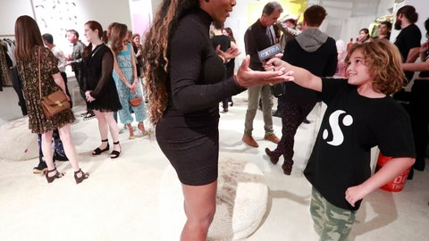 <p>               In this, Wednesday, Dec. 5, 2018 photo, Lucas Bacardi-Shriftman, 10, takes a go at interviewing tennis player Serena Williams during the launch of her first pop-up shop at the Faena Bazaar in Miami Beach, Fla. The 23-time Grand Slam champion not only designed all the clothing in the shop, but also painted all the art on walls, calling painting her outlet. (AP Photo/Wilfredo Lee)             </p>