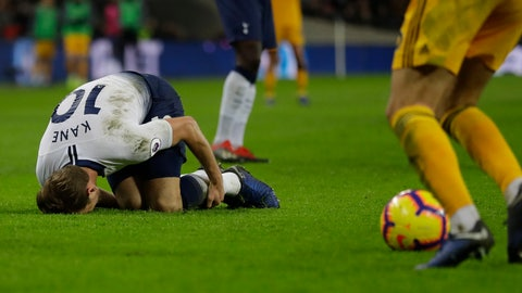 <p>               Tottenham Hotspur's Harry Kane lies on the ground after a tackle by Wolverhampton Wanderers Ivan Cavaleiro, but his booked for diving, during their English Premier League soccer match between Tottenham Hotspur and Wolverhampton Wanderers at Wembley stadium in London, Saturday, Dec. 29, 2018. (AP Photo/Kirsty Wigglesworth)             </p>
