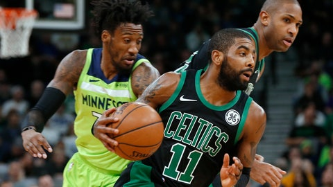 <p>               Boston Celtics' Kyrie Irving, center, drives as Minnesota Timberwolves' Robert Covington, left, pursues during the first half of an NBA basketball game Saturday, Dec. 1, 2018, in Minneapolis. At right rear is Celtics' Al Horford. (AP Photo/Jim Mone)             </p>