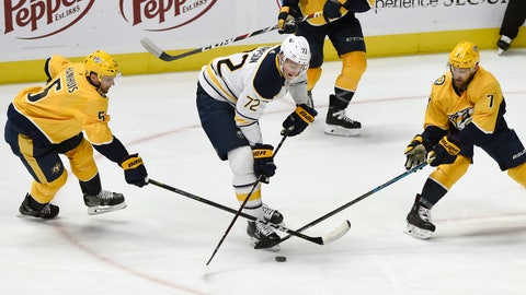 <p>               Buffalo Sabres right wing Tage Thompson (72), Nashville Predators' Dan Hamhuis (5) and Yannick Weber (7), of Switzerland, battle for the puck during the second period of an NHL hockey game Monday, Dec. 3, 2018, in Nashville, Tenn. (AP Photo/Mark Zaleski)             </p>