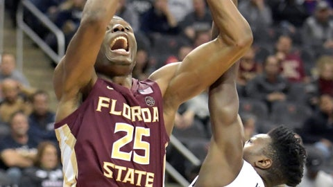 <p>               Florida State forward Mfiondu Kabengele (25) attempts a shot over Connecticut forward Kassoum Yakwe (14) during the first half of an NCAA college basketball game in the Never Forget Tribute Classic Saturday, Dec. 8, 2018, in Newark, N.J.(AP Photo/Bill Kostroun)             </p>