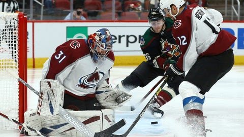 <p>               Arizona Coyotes right wing Christian Fischer (36) gets ready to send the puck past Colorado Avalanche goaltender Philipp Grubauer (31) for a goal as Avalanche defenseman Patrik Nemeth looks on during the second period of an NHL hockey game Saturday, Dec. 22, 2018, in Glendale, Ariz. (AP Photo/Ross D. Franklin)             </p>