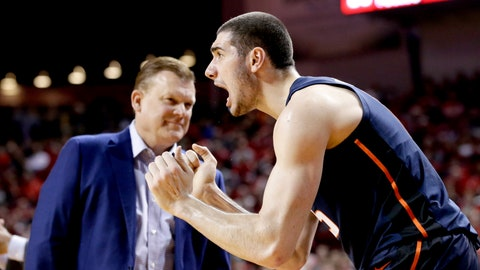 <p>               In this Dec. 2, 2018, photo, Illinois' Giorgi Bezhanishvili, right, cheers for the team in front of Illinois coach Brad Underwoodduring the second half of an NCAA college basketball game against Nebraska in Lincoln, Neb. Second-year coach Underwood has brought in eight newcomers to create the foundation for his program. The Illini have been competitive against a very difficult schedule but have won only two games. Illinois has missed the NCAA Tournament five straight years. (AP Photo/Nati Harnik)             </p>