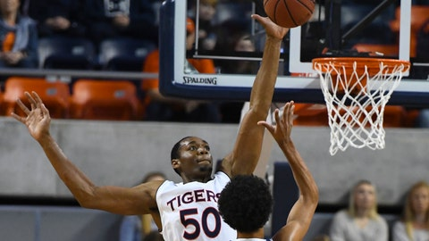 <p>               Auburn center Austin Wiley (50) blocks a shot by UNC Asheville guard Tajion Jones (3) during the first half of an NCAA college basketball game, Tuesday, Dec. 4, 2018, in Auburn, Ala. (AP Photo/Julie Bennett)             </p>