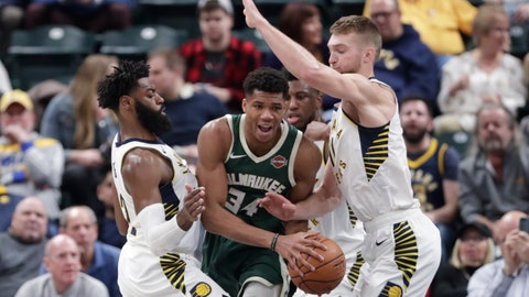 <p>               Indiana Pacers guard Tyreke Evans (12) and forward Domantas Sabonis (11) trap Milwaukee Bucks forward Giannis Antetokounmpo (34) during the first half of an NBA basketball game in Indianapolis, Wednesday, Dec. 12, 2018. (AP Photo/Michael Conroy)             </p>