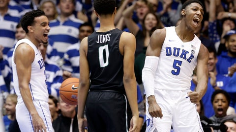 <p>               Duke's RJ Barrett (5) and Tre Jones, left, react following a dunk by Barrett while Stetson's Christiaan Jones (0) looks on during the first half of an NCAA college basketball game in Durham, N.C., Saturday, Dec. 1, 2018. (AP Photo/Gerry Broome)             </p>