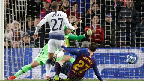 <p>               Tottenham midfielder Lucas Moura, left, scores his side's first goal during the Champions League group B soccer match between FC Barcelona and Tottenham Hotspur at the Camp Nou stadium in Barcelona, Spain, Tuesday, Dec. 11, 2018. (AP Photo/Emilio Morenatti)             </p>