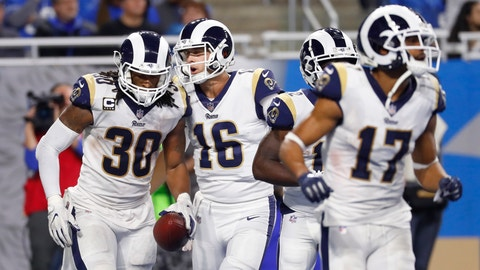 <p>               Los Angeles Rams quarterback Jared Goff (16) greets running back Todd Gurley (30) after Gurley's 13-yard rush for a touchdown during the second half of an NFL football game against the Detroit Lions, Sunday, Dec. 2, 2018, in Detroit. (AP Photo/Paul Sancya)             </p>