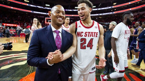 <p>               North Carolina State's Devon Daniels (24) smiles with assistant coach Takayo Siddle, left, as they walk off the court following a 78-71 victory over Auburn in an NCAA college basketball game in Raleigh, N.C., Wednesday, Dec. 19, 2018. (AP Photo/Ben McKeown)             </p>