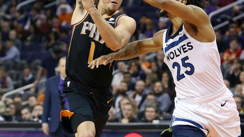 <p>               Phoenix Suns guard Devin Booker (1) makes a no-look pass over the defense of Minnesota Timberwolves' Derrick Rose during the second half of an NBA basketball game, Saturday, Dec. 15, 2018, in Phoenix. (AP Photo/Ralph Freso)             </p>
