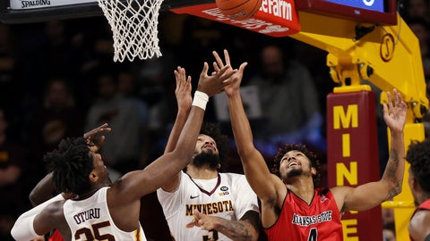 <p>               Arkansas State's Tristin Walley (4) reaches for a loose ball against Minnesota's Jordan Murphy and Daniel Oturu during  the first half of an NCAA college basketball game Saturday, Dec. 8, 2018, in Minneapolis. (AP Photo/Stacy Bengs)             </p>