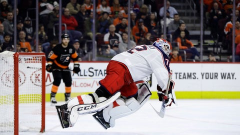 <p>               Columbus Blue Jackets' Sergei Bobrovsky lunges to block a shot during the second period of an NHL hockey game against the Philadelphia Flyers, Saturday, Dec. 22, 2018, in Philadelphia. (AP Photo/Matt Slocum)             </p>