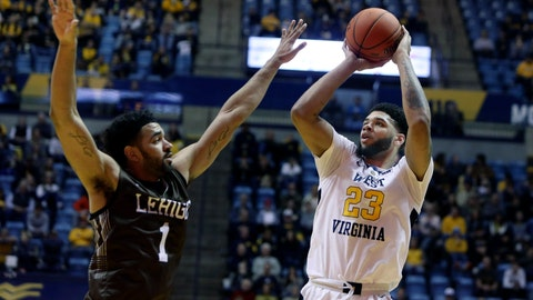 <p>               West Virginia forward Esa Ahmad (23) shoots while defended by Lehigh forward Jeameril Wilson (1) during the second half of an NCAA college basketball game Sunday, Dec. 30, 2018, in Morgantown, W.Va. (AP Photo/Raymond Thompson)             </p>