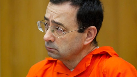 <p>               FILE - In this Jan. 31, 2018, file photo, Larry Nassar appears for his sentencing at Eaton County Circuit Court in Charlotte, Mich.  (Cory Morse/The Grand Rapids Press via AP, File)             </p>