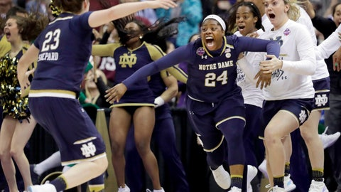 <p>               FILE - In this April 1, 2018, file photo, Notre Dame's Arike Ogunbowale (24) is congratulated by teammate Jessica Shepard (23) after sinking a 3-point basket to defeat Mississippi State 61-58 in the final of the women's NCAA Final Four college basketball tournament in Columbus, Ohio. Ogunbowale coming up big in the Final Four, twice! to lead Notre Dame to the NCAA women's basketball title. (AP Photo/Tony Dejak, FIle)             </p>