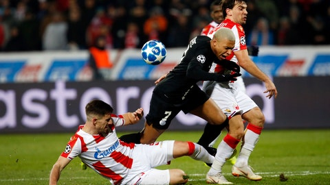 <p>               PSG forward Kylian Mbappe is tackled by Red Star's Milos Degenek, left, during the Champions League group C soccer match between Red Star and Paris Saint Germain, in Belgrade, Serbia, Tuesday, Dec. 11, 2018. (AP Photo/Darko Vojinovic)             </p>