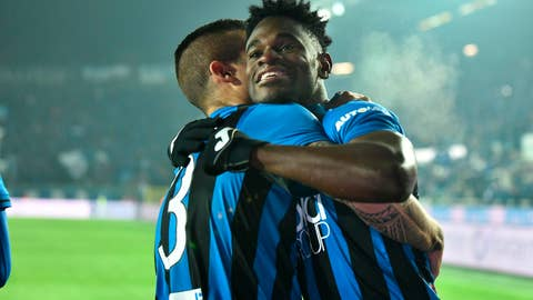 <p>               Atalanta's Duvan Zapata, right, is embraced by a teammate after scoring his team's opening goal during the Italian Serie A soccer match between Atalanta and Lazio at the Atleti Azzurri d'Italia stadium in Bergamo, Italy, Monday, Dec. 17 2018. (Paolo Magni/ANSA via AP)             </p>