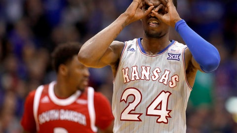 <p>               Kansas' Lagerald Vick (24) celebrates after making a basket during the second half of an NCAA college basketball game against South Dakota Tuesday, Dec. 18, 2018, in Lawrence, Kan. Kansas won 89-53. (AP Photo/Charlie Riedel)             </p>