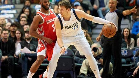 <p>               Dallas Mavericks forward Luka Doncic (77) backs down Houston Rockets guard Chris Paul (3) during the first half of an NBA basketball game, Saturday, Dec. 8, 2018, in Dallas. (AP Photo/Cooper Neill)             </p>
