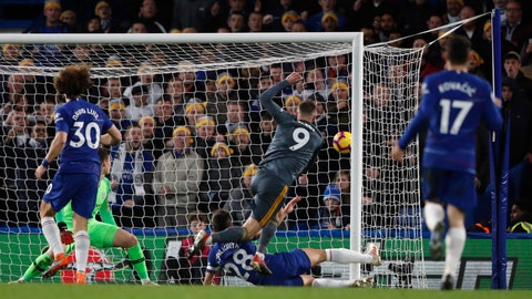 <p>               Leicester's Jamie Vardy scores his side opening goal during the English Premier League soccer match between Chelsea and Leicester City at Stamford Bridge stadium in London, Saturday, Dec. 22, 2018.(AP Photo/Frank Augstein)             </p>