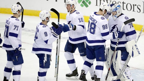 <p>               Tampa Bay Lightning goaltender Louis Domingue, far right, celebrates with defenseman Mikhail Sergachev (98), of Russia, and teammates after an NHL hockey game against the New Jersey Devils, Monday, Dec. 3, 2018, in Newark, N.J. The Lightning won 5-1. (AP Photo/Julio Cortez)             </p>