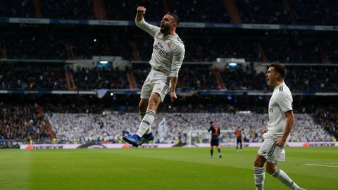 <p>               Real Madrid's Dani Carvajal, left, celebrates after Valencia's Daniel Wass scored an own goal during a Spanish La Liga soccer match between Real Madrid and Valencia at the Santiago Bernabeu stadium in Madrid, Spain, Saturday, Dec. 1, 2018. (AP Photo/Paul White)             </p>