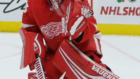 <p>               A shot deflects off the shoulder of Detroit Red Wings goaltender Jimmy Howard (35) during the first period of an NHL hockey game against the Los Angeles Kings, Monday, Dec. 10, 2018, in Detroit. (AP Photo/Duane Burleson)             </p>