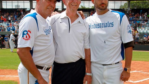 <p>               FILE - In this  Saturday, Aug. 31, 2013 file photo, three generations of exiled pitchers from the Havana town of Regla, Cuba, from left, Rene Arocha, Manuel Hurtado and Joel Hernandez, pose before a baseball game between Cuban baseball team Industriales and a team of former players now living in exile in Fort Lauderdale, Fla. Cubans can sign under rules similar to what players from Japan, South Korea and Taiwan face, according to a new agreement between Major League Baseball, its players' association and the Cuban Baseball Federation. Players from Cuba would be allowed to sign big league contracts without defecting.(Pedro Portal/El Nuevo Herald via AP, File)             </p>