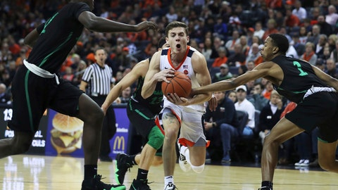 <p>               Virginia's guard Kyle Guy (5) is caught between three Marshall defenders in the first half of an NCAA college basketball game on Monday, Dec. 31, 2018, in Charlottesville, Va. (AP Photo/Zack Wajsgras)             </p>