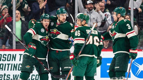 Dec 11, 2018; Saint Paul, MN, USA; Minnesota Wild right wing Nino Niederreiter (22) is congratulated after scoring a goal during the first period against the Montreal Canadiens at Xcel Energy Center. Mandatory Credit: Harrison Barden-USA TODAY Sports