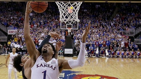 New Mexico State's C.J. Bobbitt, left, pressures Kansas' Dedric Lawson (1) on a shot during the first half of an NCAA college basketball game Saturday, Dec. 8, 2018, in Kansas City, Mo. (AP Photo/Charlie Riedel)