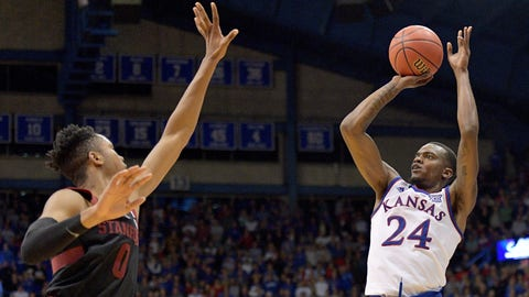 Dec 1, 2018; Lawrence, KS, USA; Kansas Jayhawks guard Lagerald Vick (24) scores a three point basket over Stanford Cardinal forward KZ Okpala (0) in overtime at Allen Fieldhouse. Kansas won 90-84. Mandatory Credit: Denny Medley-USA TODAY Sports