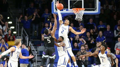 Dec 8, 2018; Tulsa, OK, USA; Tulsa Golden Hurricane guard DaQuan Jeffries (2) goes up for a block on the final seconds of the game that was missed by Kansas State Wildcats guard Barry Brown Jr. (5) in the second half of Tulsa's 47-46 victory at Reynolds Center. Mandatory Credit: Joey Johnson-USA TODAY Sports