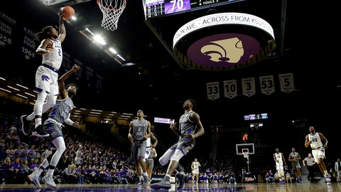 Kansas State's Cartier Diarra (2) gets past Georgia State's Devin Mitchell (24) to shoot during the second half of an NCAA college basketball game Saturday, Dec. 15, 2018, in Manhattan, Kan. (AP Photo/Charlie Riedel)