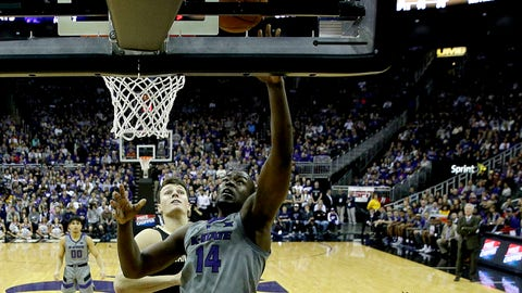 Kansas State's Makol Mawien (14) puts up a shot during the first half of an NCAA college basketball game against Vanderbilt Saturday, Dec. 22, 2018, at the Sprint Center in Kansas City, Mo. (AP Photo/Charlie Riedel)