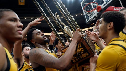 Missouri's Kevin Puryear holds the Braggin' Rights trophy as he celebrates with teammates following an NCAA college basketball game against Illinois on Saturday, Dec. 22, 2018, in St. Louis. Missouri won 79-63. (AP Photo/Jeff Roberson)