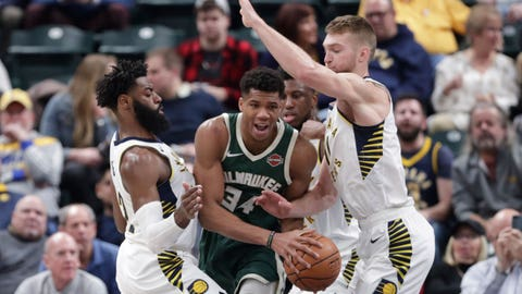Indiana Pacers guard Tyreke Evans (12) and forward Domantas Sabonis (11) trap Milwaukee Bucks forward Giannis Antetokounmpo (34) during the first half of an NBA basketball game in Indianapolis, Wednesday, Dec. 12, 2018. (AP Photo/Michael Conroy)