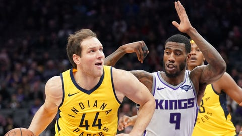 December 1, 2018; Sacramento, CA, USA; Indiana Pacers forward Bojan Bogdanovic (44) dribbles the basketball against Sacramento Kings guard Iman Shumpert (9) during the first quarter at Golden 1 Center. Mandatory Credit: Kyle Terada-USA TODAY Sports