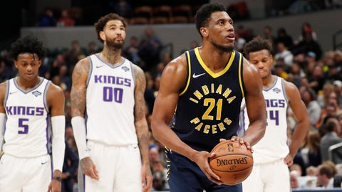 Dec 8, 2018; Indianapolis, IN, USA; Indiana Pacers forward Thaddeus Young (21) shoots a free throw after as Sacramento Kings center Willie Cauley-Stein (00) looks on during the fourth quarter at Bankers Life Fieldhouse. Mandatory Credit: Brian Spurlock-USA TODAY Sports